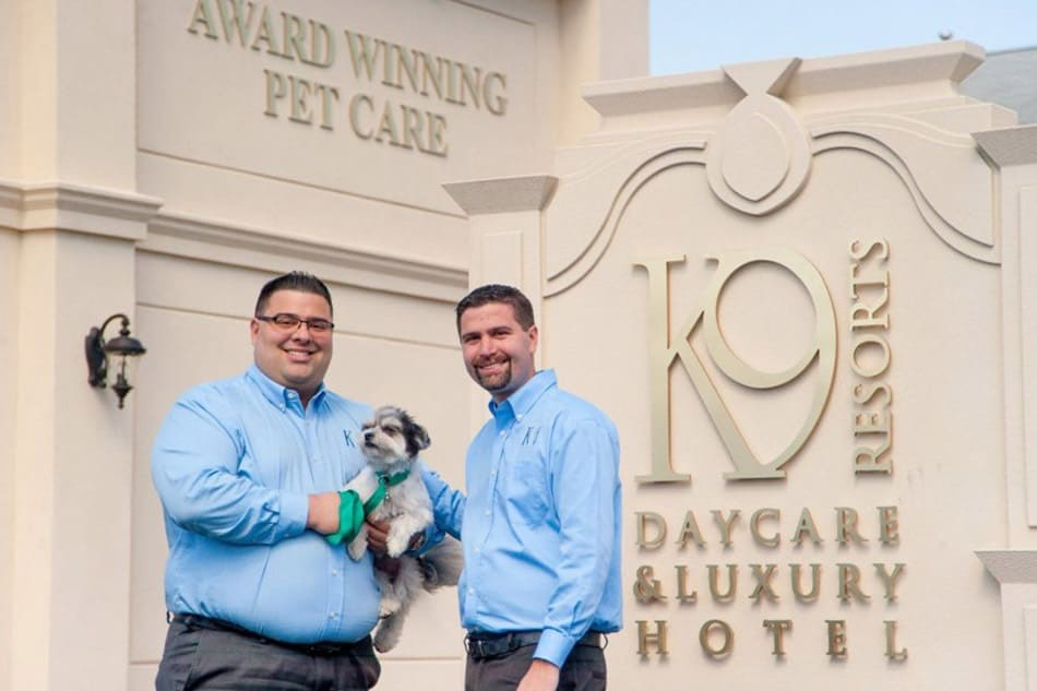 Photo of Steven and Jason Parker in front of K9 Resorts Luxury Pet Hotel
